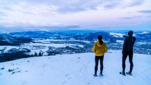 Two trail runners looking towards Missoula from the top of Mt. Sentinel during the Up For Air Series event.